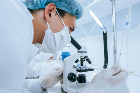 close up. scientist using a microscope in a modern laboratory.