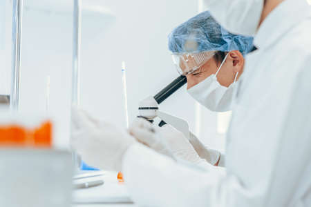 close up. group of virologists in protective clothing works in the laboratory.