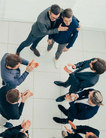 top view. boss and business team congratulating the best employee .