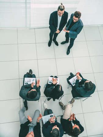 top view. business team congratulating the best employee.