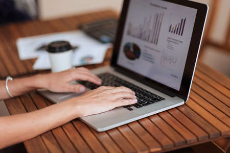 close up. businesswoman using a laptop to work with financial data .