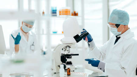 close up. virologists work in the laboratory .