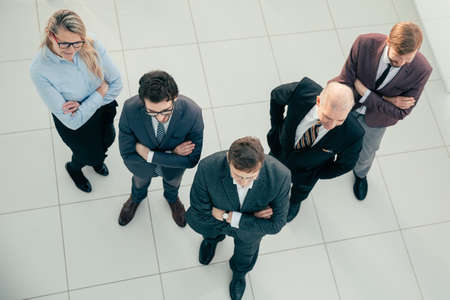 top view. team of confident professionals standing in the office. 版權商用圖片