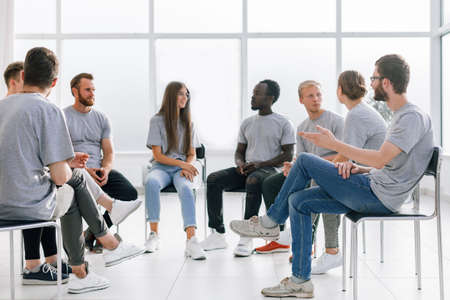 group of young like-minded people discussing their ideas