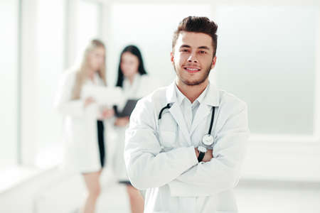 successful pediatrician standing in the hallway of the medical
