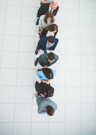 top view. diverse business of people standing in line for interviews.
