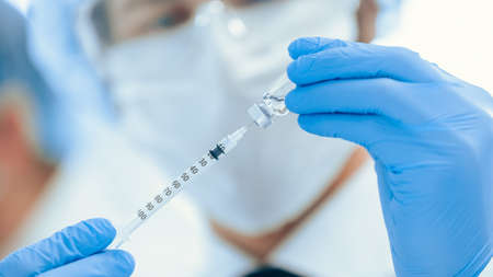 close up. scientist filling the syringe with the new vaccine . Stockfoto