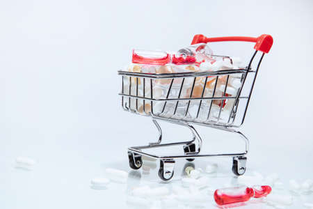 image of a shopping cart with various medications.