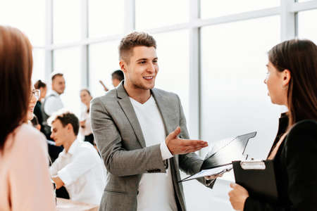 employees discuss new ideas standing in the office