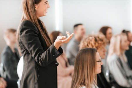 close up. young woman standing among the audience in the confer