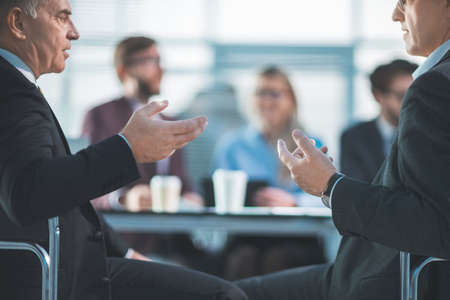 business colleagues argue sitting at the office table