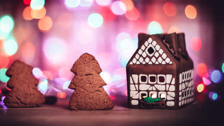 gingerbread house and cookies are a festive background