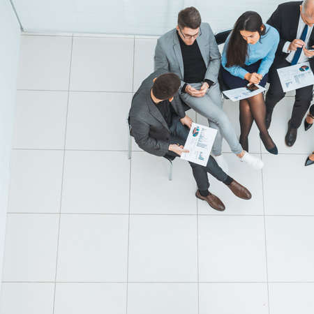 top view. group of employees sitting in a conference room.