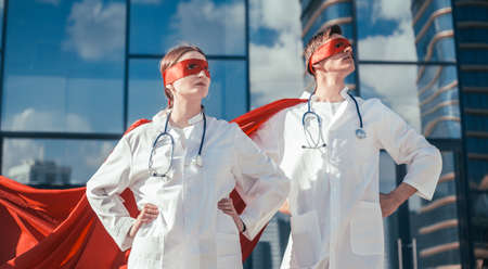 close up. doctors are superheroes standing on a city street .