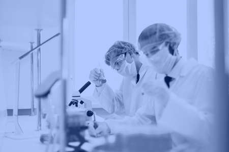 close up. group of scientists conduct research in the laboratory .
