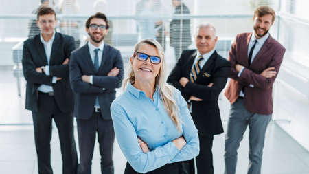 proud business woman standing in front of a business team Stock fotó
