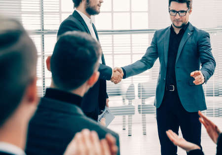 business colleagues shaking hands with each other . Stock fotó