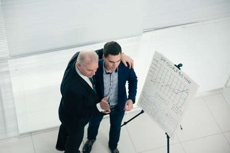 top view. project Manager and employee standing near the flipchart Stock fotó