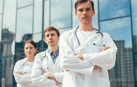close up. team of doctors standing on a city street.