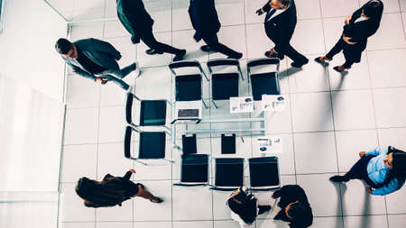 top view. a group of business people walking to the negotiating table
