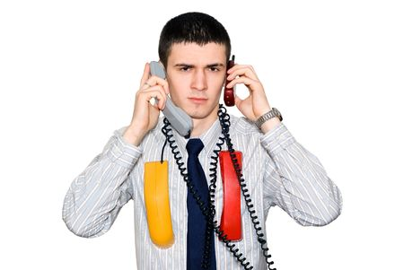 simultaneously: The young man speaks simultaneously by two phones
