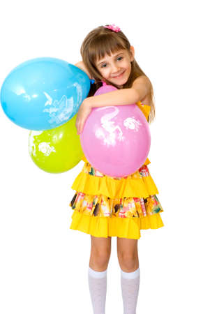 The girl in yellow clothes with balloons