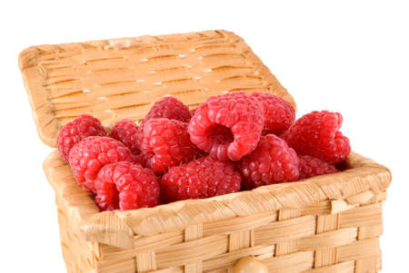 bacca: The bast-basket with a raspberry is photographed on a white background