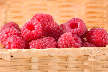 bacca: The bast-basket with a raspberry is photographed a close-up Stock Photo