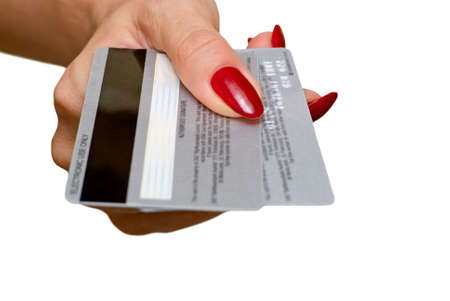 The female hand holds two credit cards