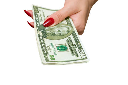 The female hand holds some denominations on 50 dollars Stock Photo
