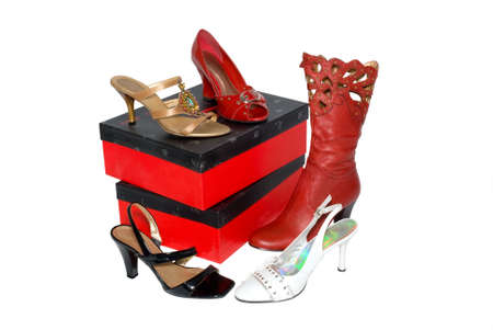 The footwear is photographed near red boxes on a white background