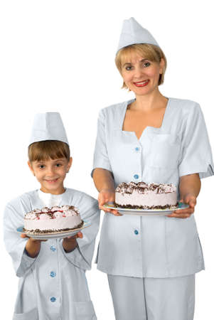 The confectioner and hers small assistant are photographed with a cake