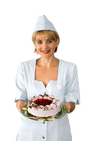 The confectioner is photographed with a cake
