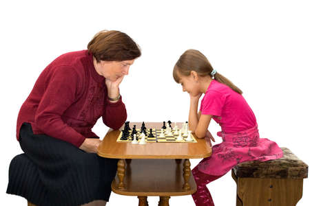 The grandmother and the granddaughter play a chess