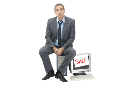 The needy businessman sells office technics Stock Photo