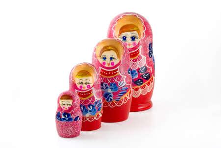 russian nested dolls: Russian nested dolls are photographed on white