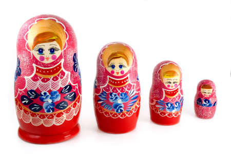 nested: Russian nested dolls are photographed on white