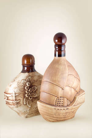 The two ceramic bottles are photographed close-up photo