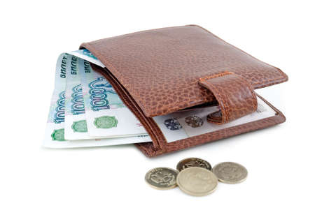 Brown leather wallet and denominations in one thousand roubles