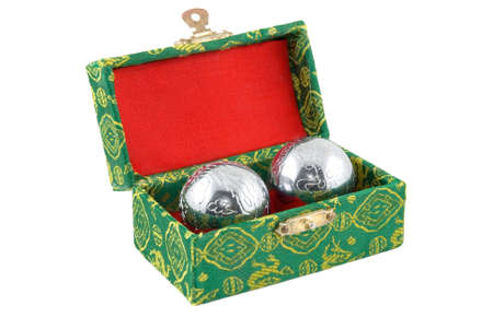 lustre: The Chinese souvenir - two metal spheres in a green - red box Stock Photo