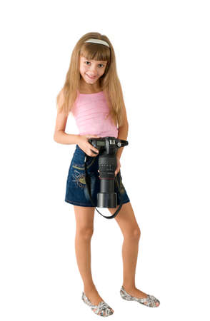 The girl - photographer is photographed on the white background