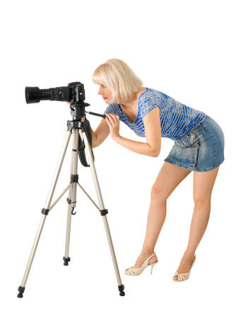 The lady - photographer is photographed on the white background Stock Photo