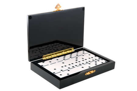 Casket with dominoes is photographed on the white background photo