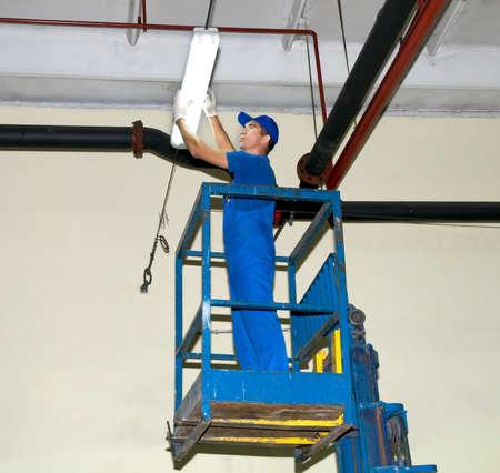 The electrician repairs illumination