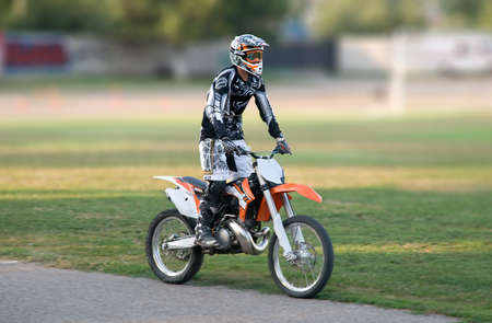 The racer on an orange motorcycle Stock Photo - 11565062