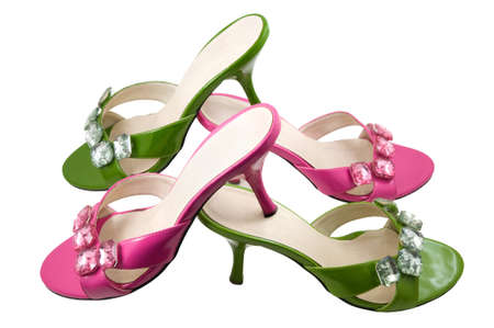 heel strap: Two pairs pink and green shoes are photographed on a white background