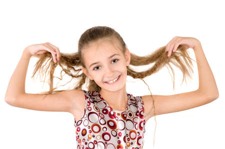 loose hair: The girl holds the loose hair in hands