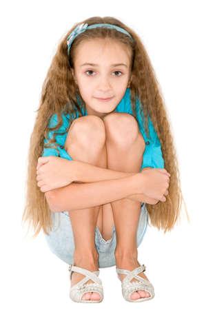 faldas: Muchacha en la blusa azul en el fondo blanco