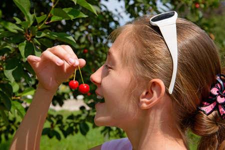 Girl eats cherry