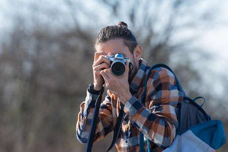 Photographer with a camera shot closeup